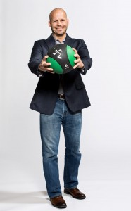 President Dave Mortensen holding a medicine ball. View larger image.