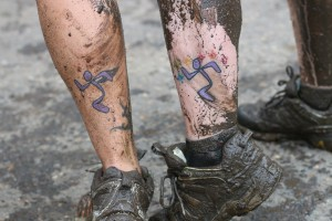 Runningman logo tattoo. More than 3,000 Anytime Fitness gym owners, employees, and members have Runningman logo tattoos. View larger image.