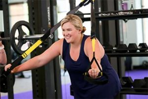 Woman working out with trx bands
