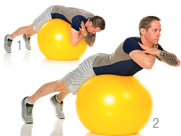 man on exercise ball doing back extension