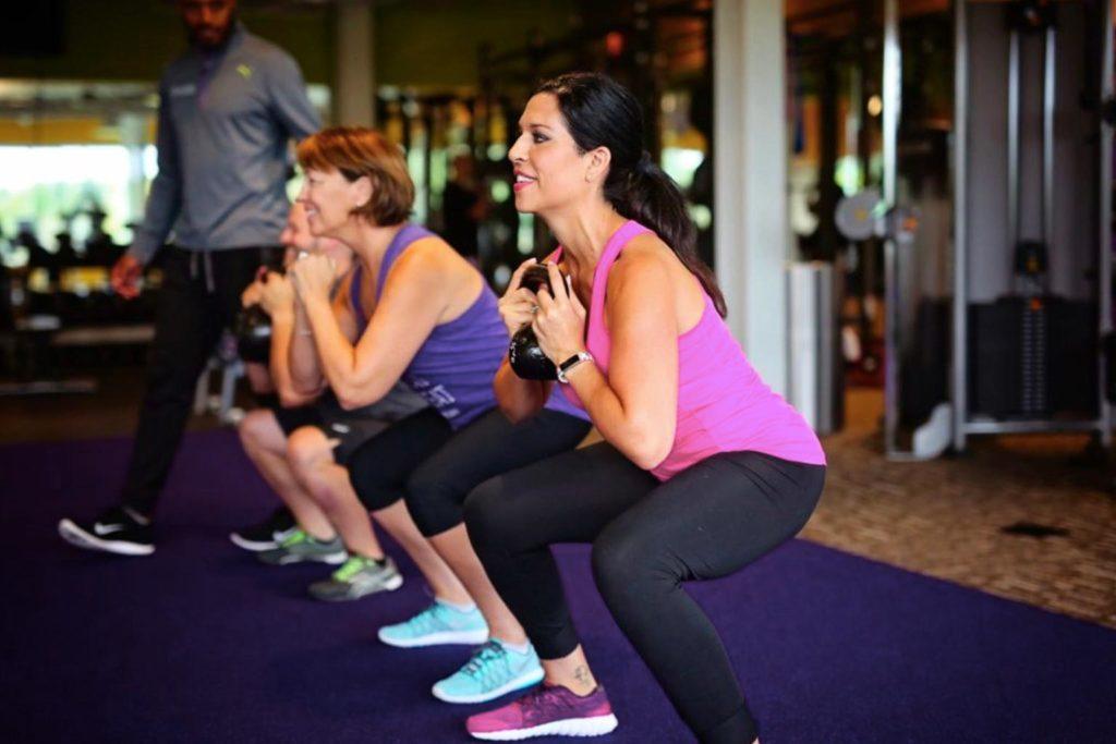 women doing squats