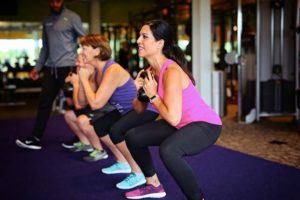 women doing squats