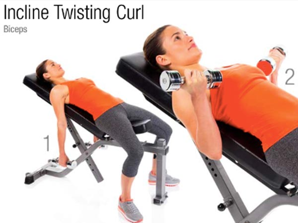 woman doing Incline Twisting Curl