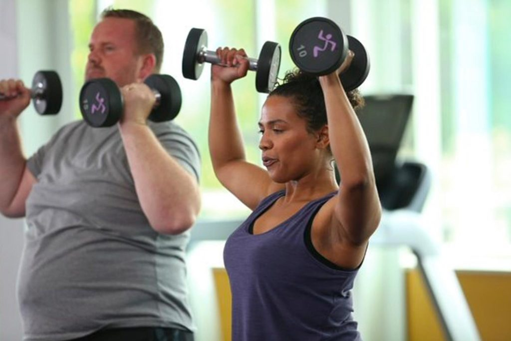 woman working out with dumb bells