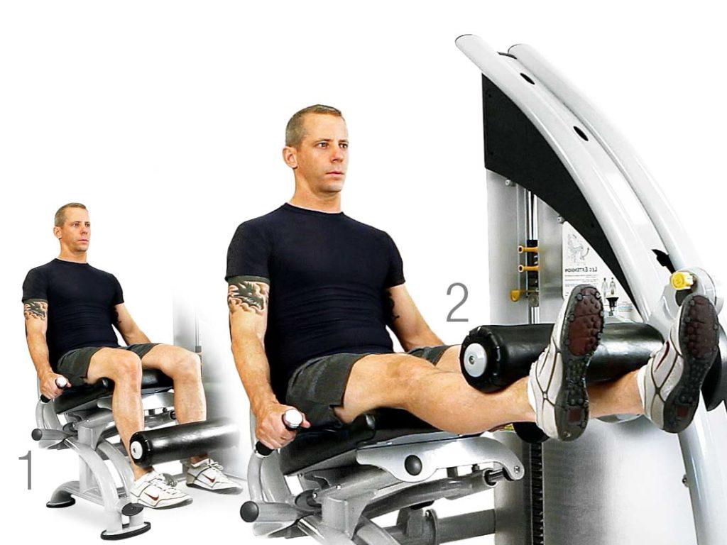 Man using leg extension machine