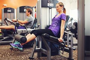 woman working out with a leg curl