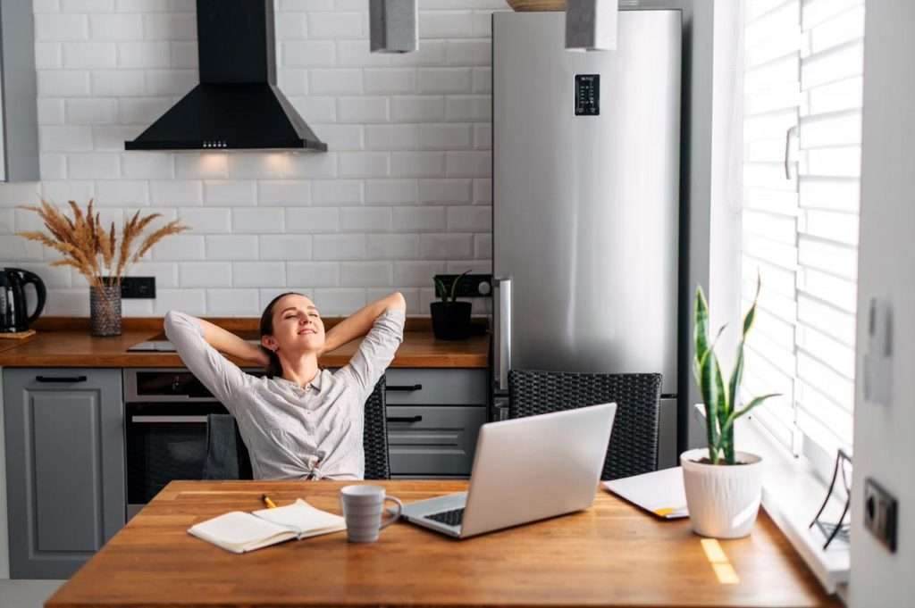 woman relaxing in front of computer