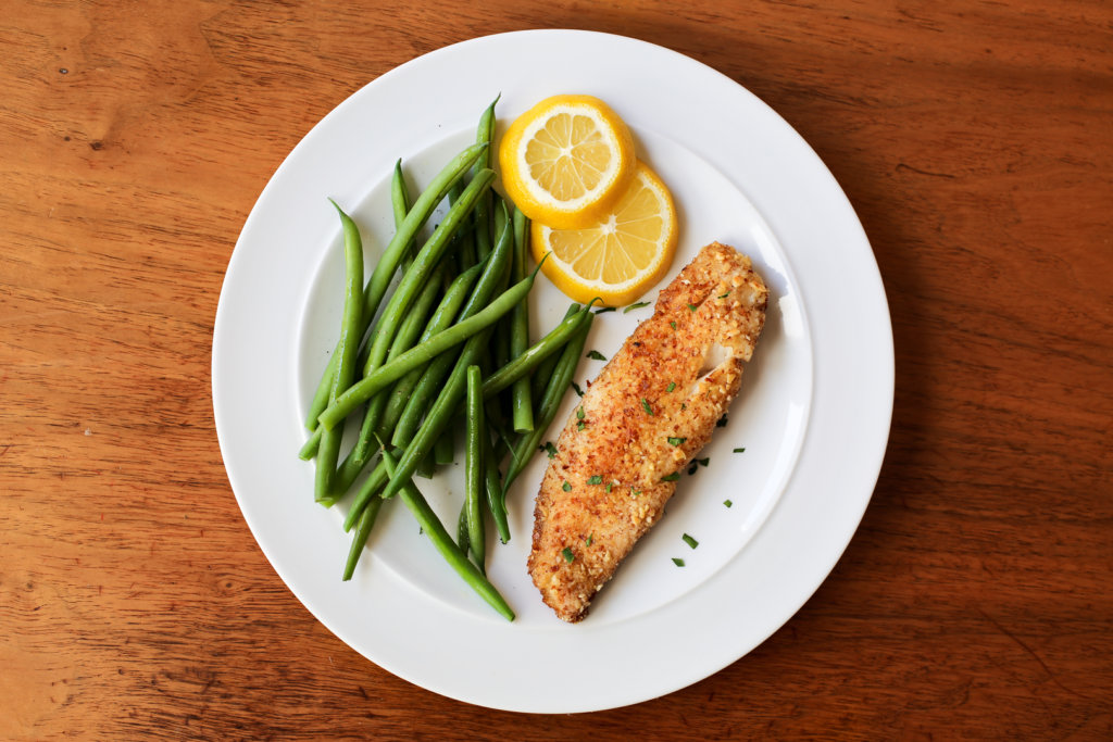 Photo of almond crusted tilapia on a plate